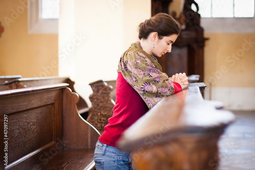 Young woman praying in a church