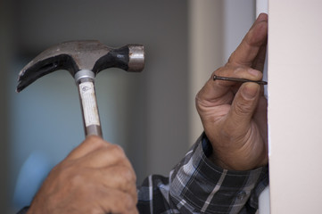 dribing the nail with hammer