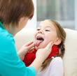 Doctor is examining little girl