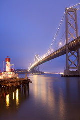 Bay Bridge under the cloudy sky at night, San Francisco
