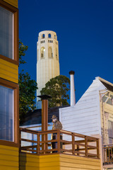 Coit Tower and man sculpture at night in San Francisco