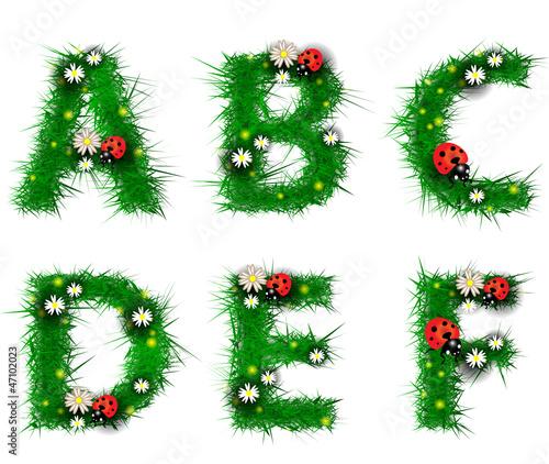 Grass letters a, b, c, d, e, f