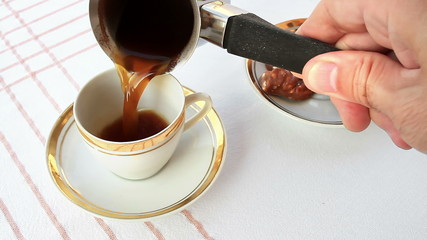 Serving a cup of coffee
