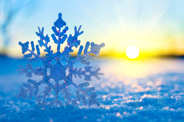 Decorative snowflake against the setting sun