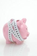 Sparschwein und Messband
