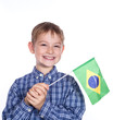 A little boy with brazilian flag on the white background