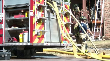 Firemen Talking at Fire Emergency