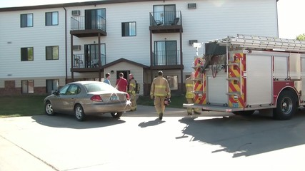 Fireman Talking to Victims at Emergency