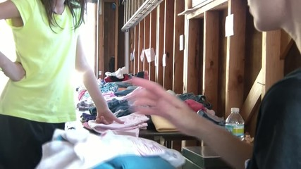 Girl Shopping at Garage Sale Buys Clothes