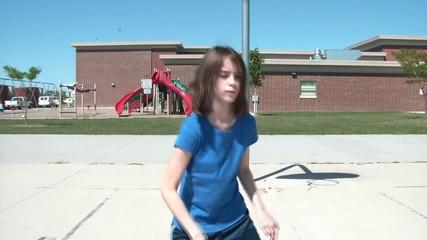 Girl Dribbling Basketball on Court