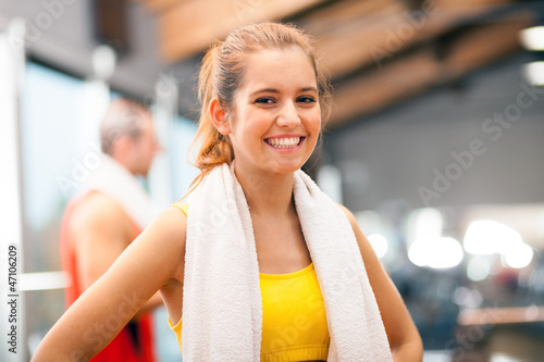 Girl smiling in a fitness club