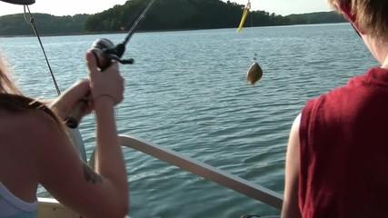 Kids Fishing on Lake in Summer