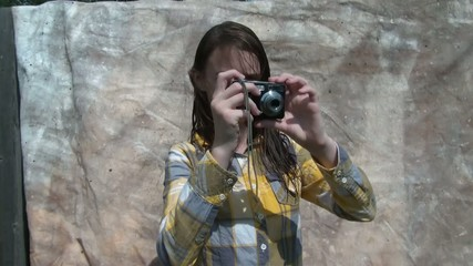 Girl Taking Pictures with Camera & Modeling