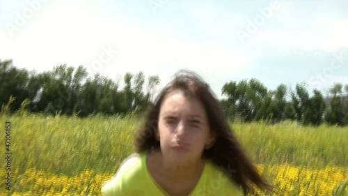 Girl Sits in Yellow Flower Field