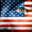 Flag painted on face with green eye to show USA support