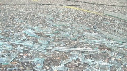Glass Shattering - Sweeping Into Pile
