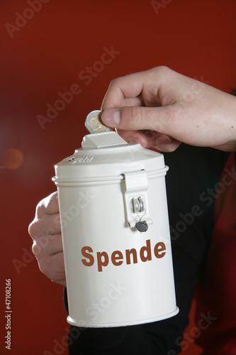 Leinwanddruck Bild Eine Spendendose