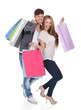 Guy and gal brings shopping bags