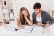 Unhappy young couple in financial trouble