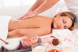 Client relaxing in massage parlor poster