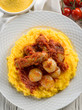 porridge with sausage and tomatoes sauce