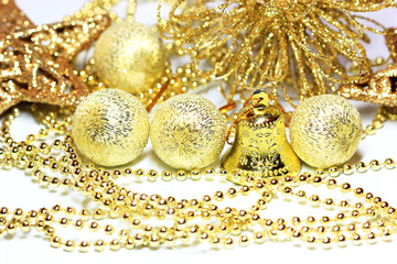 Balls and bell on the background of golden christmas stuff
