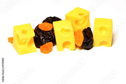 slices of cheese with raisins and prunes