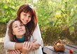 Young smiling woman with her teen daughter