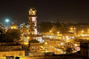 The Clock Tower illuminated at night in Jodhpur