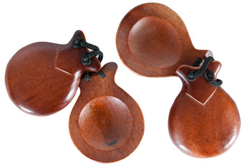 Two pair castanets on a white background