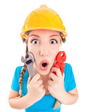 Surprised woman wearing a hardhat holding pliers and spanner