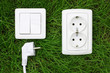 power receptacle and light switch on a green grass