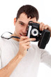 Handsome man with camera in hands