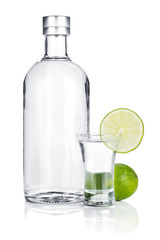 Bottle of vodka and shot glass with lime slice