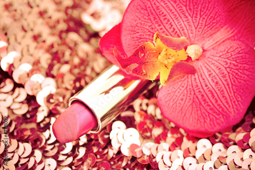 red lipstick on glitters with orchid