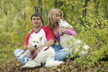 couple in the woods with the dogs fall happiness