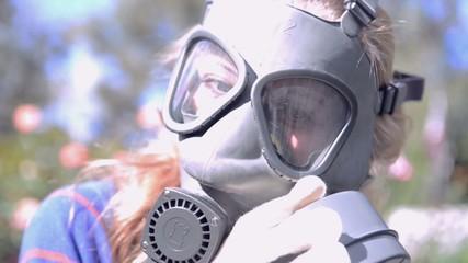 girl wears gas masks