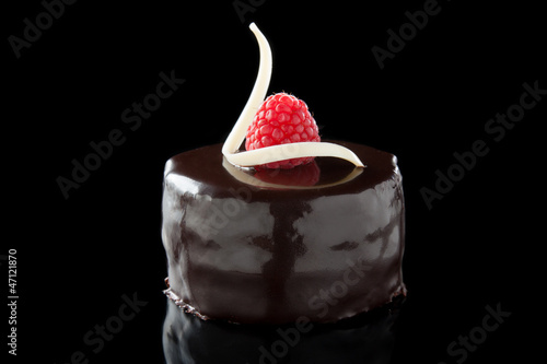 chocolate cake decorated with raspberries