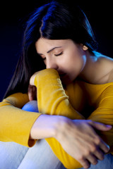 Depressed lonely beautiful woman with closed eyes
