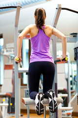 Young woman doing exercises in a fitness center