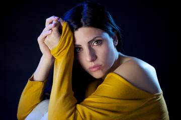 Sad beautiful woman looking