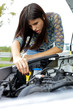 Woman checking car broken engine