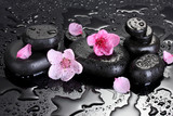 Spa stones with drops and pink sakura flowers - 47124830