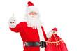 Santa Claus holding a bag and giving a thumb up