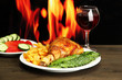 Roast chicken with french fries and cucumbers, glass of wine