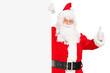 Santa claus holding a billboard and giving a thumb up