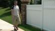 Man Answers Cellphone on Sidewalk