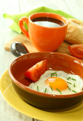 Breakfast of fried egg and the cup of coffee