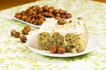 Hazelnuts and slice of apple cake