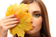 portrait of young woman with autumn maple leaves, isolated